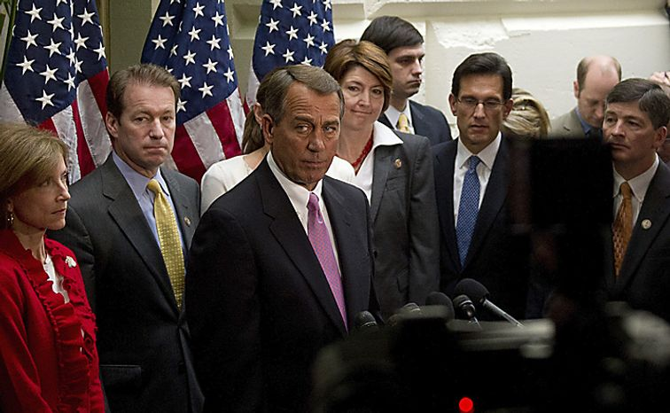 GOP leadership led by Speaker of the House Rep. John Boehner (R-OH) offers remarks during a break as they caucus at the Capitol in Washington, D.C., Friday, April 8, 2011. (Rod Lamkey Jr./The Washington Times)