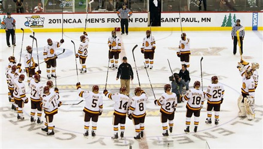 Minnesota Duluth fans cheer during the third period of an NCAA Frozen Four college semifinal hockey game against Notre Dame in St. Paul, Minn., Thursday, April 7, 2011. Minnesota Duluth defeated Notre Dame 4-3.  (AP Photo/Ann Heisenfelt)