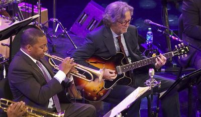 This Thursday, April 7, 2011 photo courtesy of Julie Skarratt shows, from left to right, Jazz at Lincoln Center Artistic Director Wynton Marsalis, musician Eric Clapton and blues legend Taj Mahal during Jazz at Lincoln Center's 2011 Annual Gala in New York. The organization raised more than $3.6 million dollars via the Gala, which will benefit the thousands of performance, education and broadcast events that the organization produces each year.   (AP Photo/Julie Skarratt)