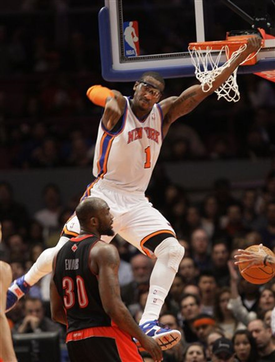 New York Knicks' Amare Stoudemire (1) dunks the ball as Toronto Raptors' Reggie Evans (30) looks on during the second half of an NBA basketball game Tuesday, April 5, 2011, in New York. The Knicks won the game 131-118. (AP Photo/Frank Franklin II)