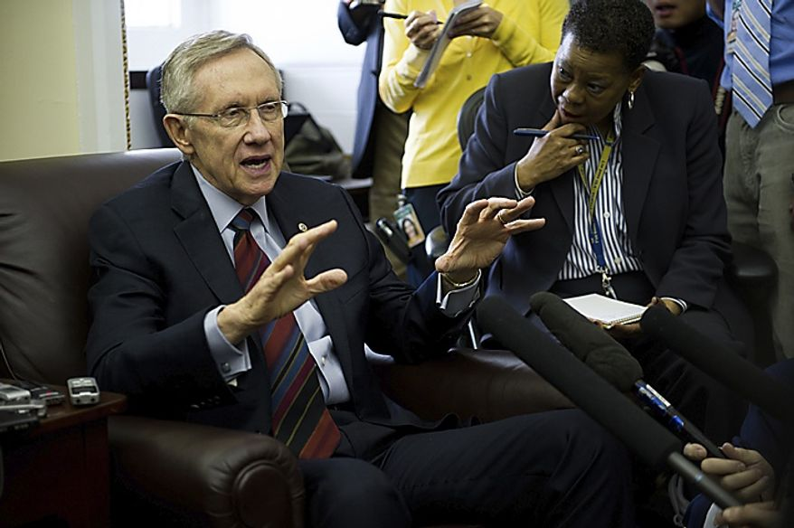 Senate Majority Leader Harry Reid, Nevada Democrat, talks to reporters during a pad-and-pen session at the Capitol in Washington, D.C., Friday, April 8, 2011. (Rod Lamkey Jr./The Washington Times)