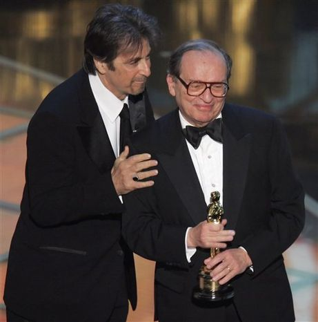 """FILE - In this Sunday, Feb. 27, 2005 file picture, director Sidney Lumet, right, receives an honorary Oscar from the Academy of Motion Picture Arts and Sciences during the 77th Academy Awards telecast in Los Angeles, presented by actor Al Pacino. Lumet, the award-winning director of such acclaimed films as """"Network,"""" """"Serpico,"""" """"Dog Day Afternoon"""" and """"12 Angry Men,"""" has died his family said Saturday, April 9, 2011. He was 86. (AP Photo/Mark J. Terrill)"""