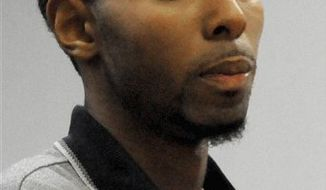 FILE - In this Oct. 28, 2009 file photo Hakim Muhammad, of Bloomfield, Conn., is arraigned  in a courtroom at Rockville Superior Court, in Vernon, Conn. Muhammad, 22, was sentenced Friday, April 8, 2011, in Rockville Superior Court to 2-1/2 years in prison and 2-1/2 years of special parole after pleading guilty to second-degree assault and hindering prosecution. He also apologized for stabbing UConn football player Brian Parker during an October 2009 fight on the campus. (AP Photo/George Ruhe, File)