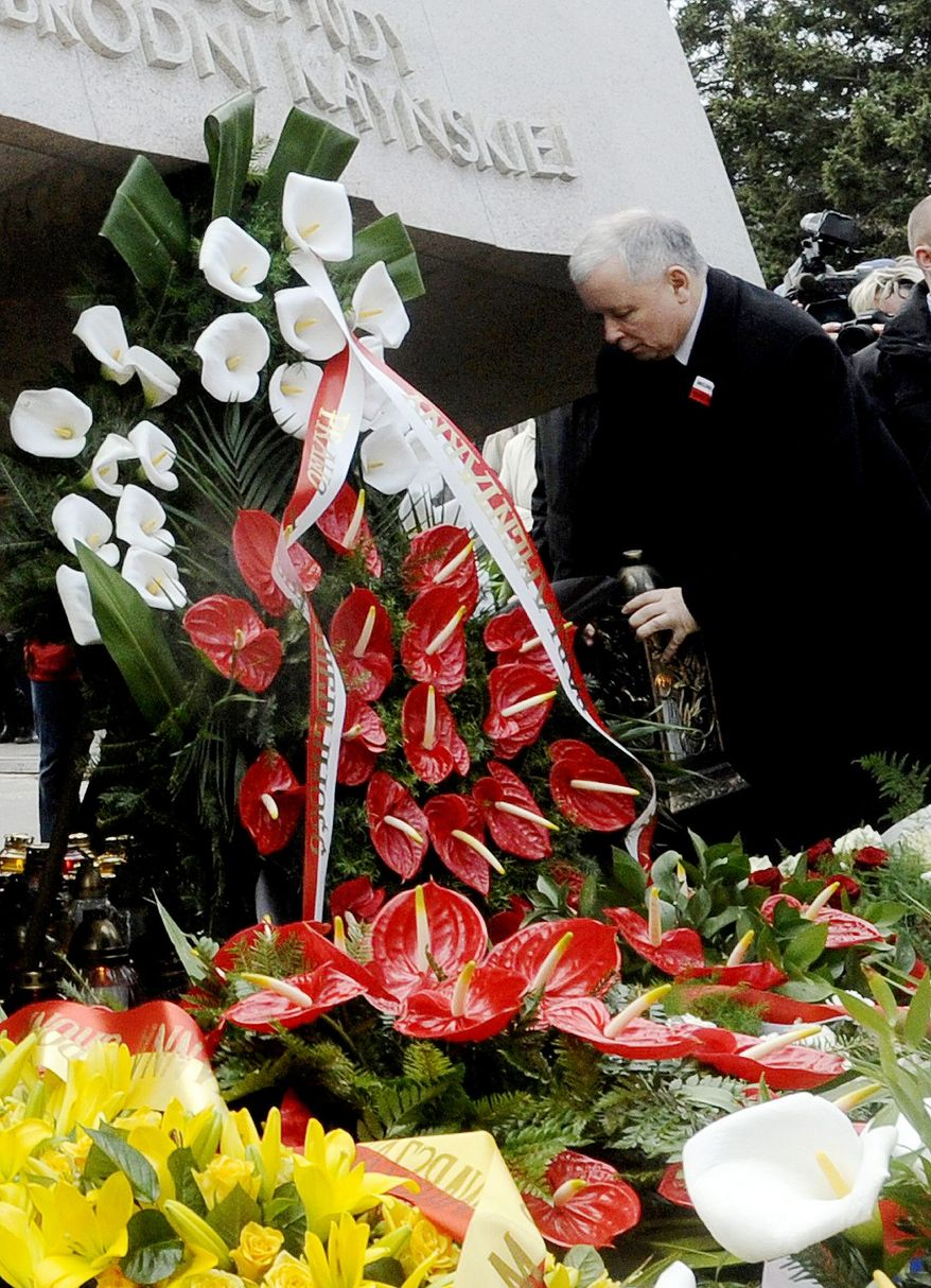 Polish opposition leader Jaroslaw Kaczynski places a candle at the memorial dedicated to his twin brother, Lech, and the other passengers who died in the plane crash near Smolensk, Russia, on April 10, 2010. (Associated Press)