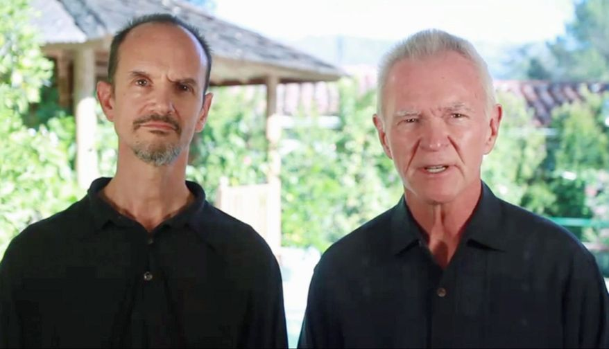 """Arjuna Ardagh and Gay Hendricks stand together in a pastoral setting during the opening sequence of their YouTube video, """"Dear Women."""" (YouTube screen grab)"""
