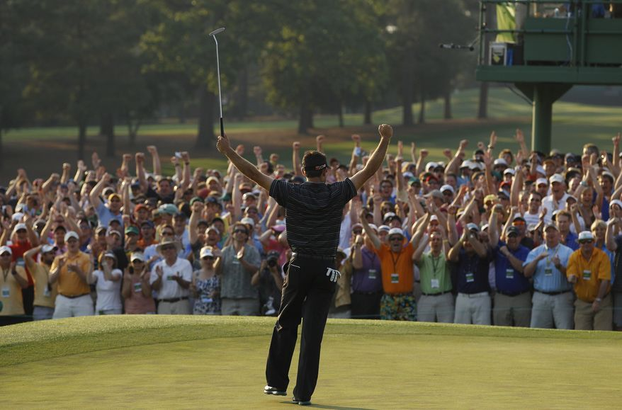 Charl Schwartzel of South Africa reacts after making a birdie putt on the 18th hole during the final round of the Masters golf tournament Sunday, April 10, 2011, in Augusta, Ga. (AP Photo/Matt Slocum)