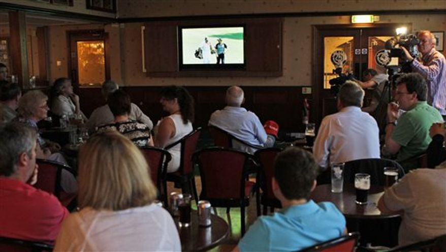 Golfers react as they watch tv at Rory McIlroy's home club of Holywood Golf Club, situated on the outskirts of Belfast, Northern Ireland, Sunday, April, 10, 2011, as he bogeys the first hole in the Masters Golf Championship in Augusta, Georgia.  (AP Photo/Peter Morrison)