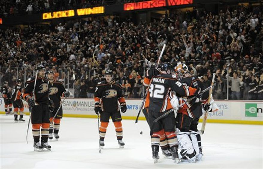 Los Angeles Kings left wing Ryan Smyth, top, trips over Anaheim Ducks center Ryan Getzlaf during the first period of their NHL hockey game on Friday, April 8, 2011, in Anaheim, Calif. (AP Photo/Mark J. Terrill)