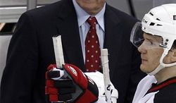 New Jersey Devils coach Jacques Lemaire, rear, stands behind his bench during the first period of an NHL hockey game against the Pittsburgh Penguins in Pittsburgh Tuesday, April 5, 2011. The Penguins won 4-2. (AP Photo/Gene J. Puskar)