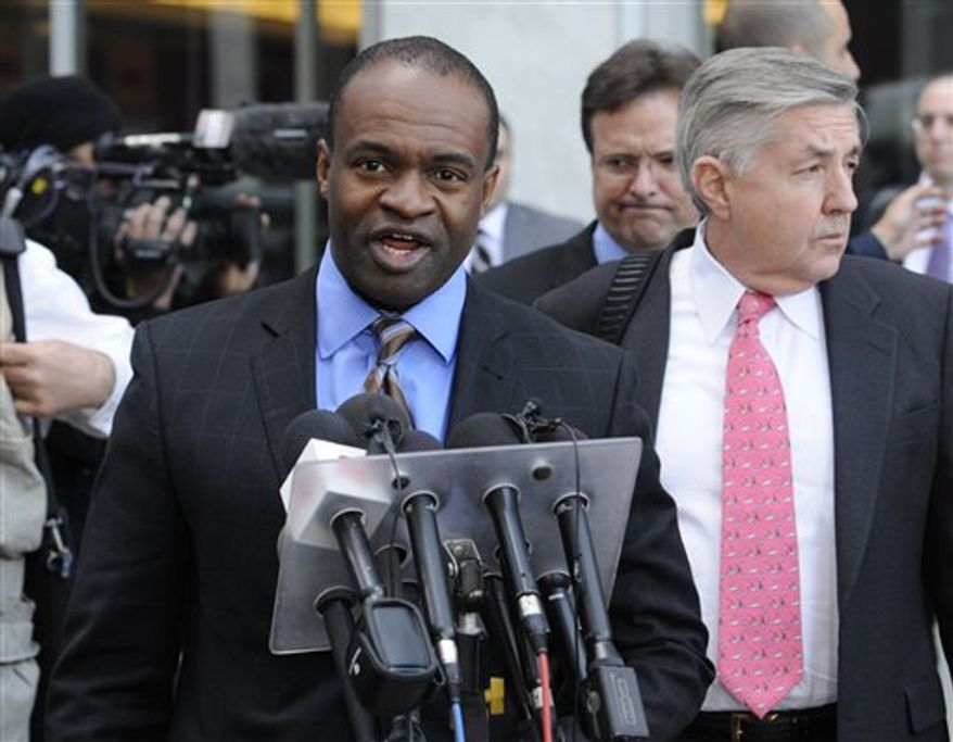 DeMaurice Smith, who was head of the NFL Players Association before it dissolved, talks to reporters outside the federal courthouse after a hearing Wednesday, April 6, 2011, in St. Paul, Minn. At right is players attorney Jim Quinn. A group of players is asking a judge to issue a preliminary injunction on the lockout the owners imposed after talks on a new collective bargaining agreement broke off three weeks ago. (AP Photo/Jim Mone)