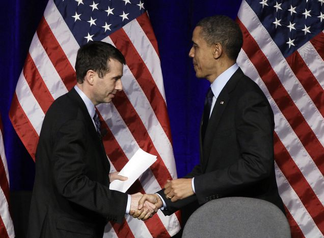 ** FILE ** President Obama is introduced by White House Senior Adviser David Plouffe before the president speaks at a Democratic National Committee event in Washington on Wednesday, March 16, 2011. (AP Photo)