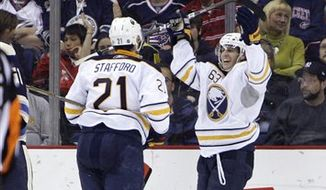Buffalo Sabres' Tyler Ennis, right, celebrates his goal against the Columbus Blue Jackets with teammate Drew Stafford during the second period of an NHL hockey game Saturday, April 9, 2011, in Columbus, Ohio. (AP Photo/Jay LaPrete)