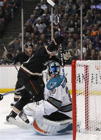 Anaheim Ducks center Ryan Getzlaf, left, celebrates after teammate Cam Fowler scored in the first period of an NHL hockey game against the San Jose Sharks in Anaheim, Calif., Wednesday, April 6, 2011. Standing at right is San Jose Sharks center Logan Couture. (AP Photo/Jae C. Hong)