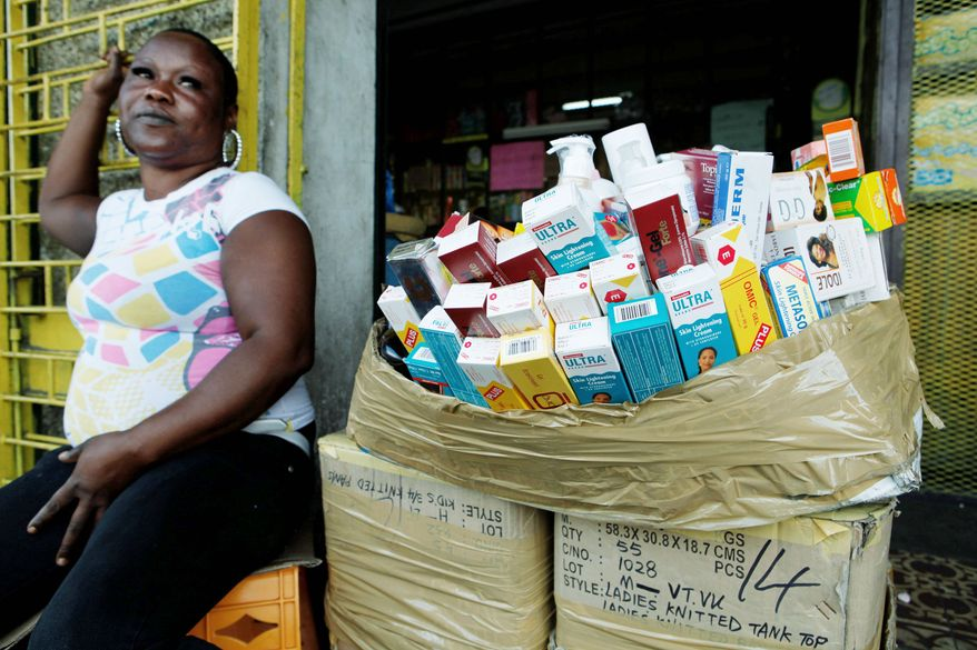 Roadside vendor Sophia McLennan sells a variety of skin-bleaching agents in Kingston. Lightening creams, powders and ointments are not effectively regulated in Jamaica. (Associated Press)