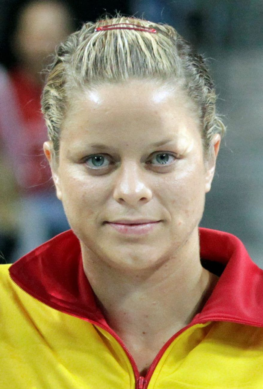 FILE - This Feb. 6, 2011, file photo shows Belgium's Kim Clijsters, in Antwerp, Belgium. Clijsters may miss next month's French Open after injuring her right ankle at her cousin's wedding. Her website says she will be out at least four to six weeks. (AP Photo/Yves Logghe, File)