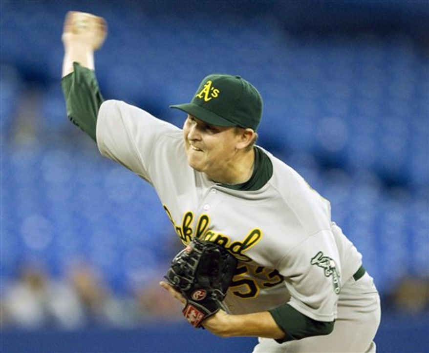 Oakland Athletics starting pitcher Trevor Cahill pitches during fourth inning AL action against the Toronto Blue Jays in Toronto on Thursday, April 7, 2011. (AP Photo/The Canadian Press, Frank Gunn)