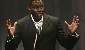 ** FILE ** Olympic gold medalist Carl Lewis speaks during his induction into the New Jersey Hall of Fame in Newark, N.J., in May 2010. (AP Photo/Rich Schultz, File)