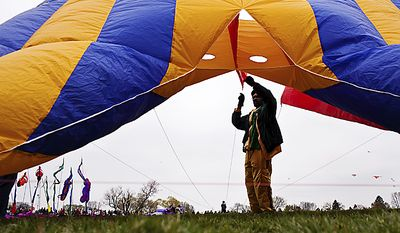 Kaziah Hall of the West Indian American Kite Association prepares to launch a large kite during the annual Blossom Kite Festival on the National Mall in Washington on Sunday, April 10, 2011. (Drew Angerer/The Washington Times)