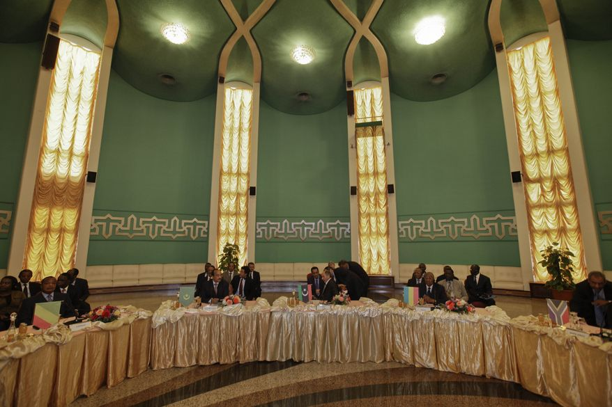 An African Union delegation meets with Libyan rebel leaders at the Tibesty Hotel in Benghazi, Libya, on Monday, April 11, 2011. The AU delegation took its cease-fire proposal to the rebels' eastern stronghold and was met with protests by crowds opposed to any peace until the country's longtime leader, Col. Moammar Gadhafi, gives up power. (AP Photo/Ben Curtis)
