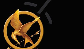 "Book cover for ""The Hunger Games"" by Suzanne Collins"