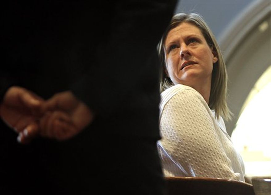 Kristen LaBrie talks to a court officer during a recess after she was found guilty on all four counts including attempted murder, in the death of her son, at Lawrence Superior Court in Lawrence, Ma, Tuesday, April 12, 2011.  LaBrie was also convicted of child endangerment and assault and battery for failing to give her son, Jeremy Fraser, chemotherapy medications after the boy was diagnosed with non-Hodgkins lymphoma. He died in 2009 at age 9.  (AP Photo/Cheryl Senter)