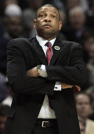 Boston Celtics' Paul Pierce reacts after talking to head coach Doc Rivers during the third quarter of an NBA basketball game against the Chicago Bulls in Chicago, Thursday, April 7, 2011. The Bulls won 97-81. (AP Photo/Nam Y. Huh)