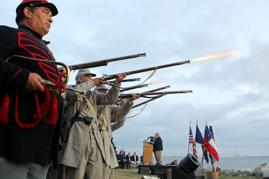 Civil War re-enactors fire a 21-gun salute at Fort Johnson, near Fort Sumter, in Charleston, S.C., on Tuesday, April 12, 2011, to commemorate the moment the first shots of the Civil War were fired 150 years ago. (AP Photo/Alice Keeney)