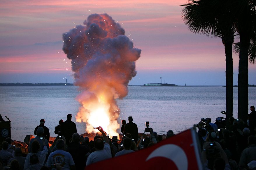 Cannon blasts from Fort Johnson across Charleston Harbor toward Fort Sumter at daybreak on Tuesday, April 12, 2011, in Charleston, S.C., signal the commemoration of the start of the Civil War 150 years ago. (AP Photo/Post and Courier, Wade Spees)