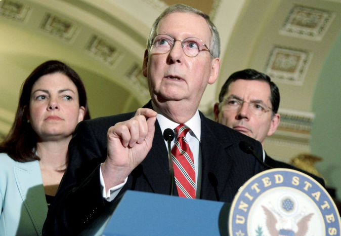"Flanked by fellow Republican Sens. Kelly Ayotte of New Hampshire and John Barrasso of Wyoming, Senate Minority Leader Mitch McConnell of Kentucky speaks to reporters Tuesday. ""The debate has turned from how much to grow government to how much to reduce it,"" he said. (Associated Press)"