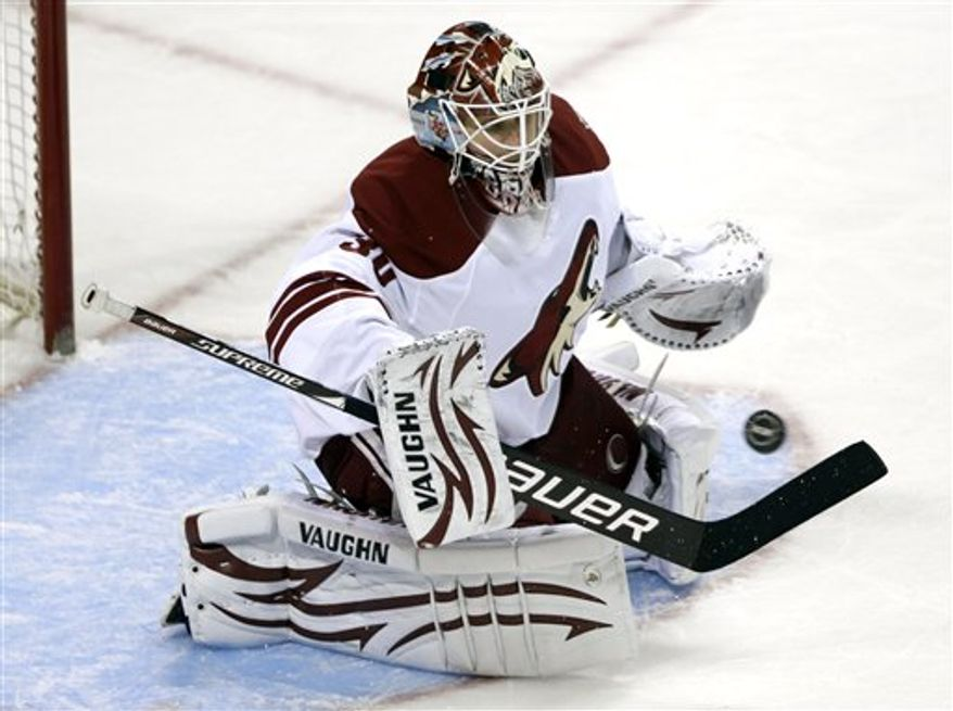 San Jose Sharks right wing Dany Heatley (15) is unable to score past Phoenix Coyotes goalie Ilya Bryzgalov (30), of Russia, in the first period of an NHL hockey game in San Jose, Calif., Saturday, April 9, 2011. (AP Photo/Paul Sakuma)