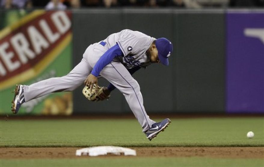 Los Angeles Dodgers shortstop Rafael Furcal misses a ground ball hit by the San Francisco Giants' Madison Bumgarner third inning of their baseball game in San Francisco, Monday, April, 11, 2011. Bumgarner got a single on the play. (AP Photo/Eric Risberg)