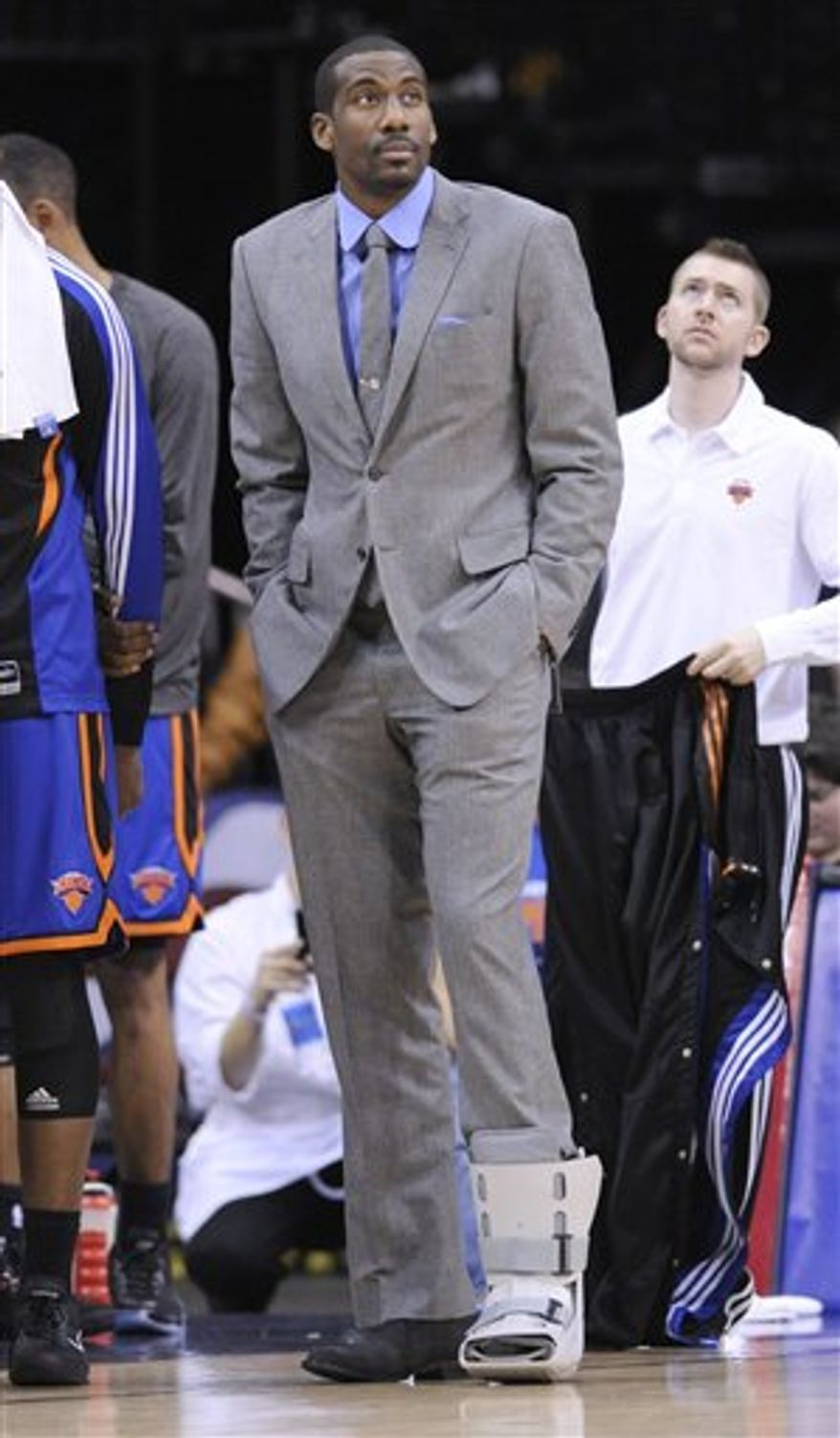 New York Knicks' Amar'e Stoudemire wears a boot on his foot as he looks on during a timeout in the fourth quarter of an NBA basketball game against the New Jersey Nets Friday, April 8, 2011 in Newark, N.J. The Knicks won 116-93. (AP Photo/Bill Kostroun)