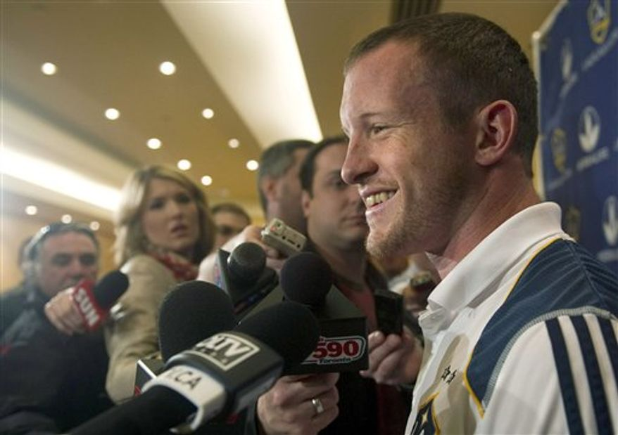 Los Angeles Galaxy soccer player Chad Barrett speaks to the media during a news conference in Toronto on Tuesday, April 12, 2011. The Galaxy taken on Toronto FC in an MLS soccer match on Wednesday. (AP Photo/The Canadian Press, Nathan Denette)