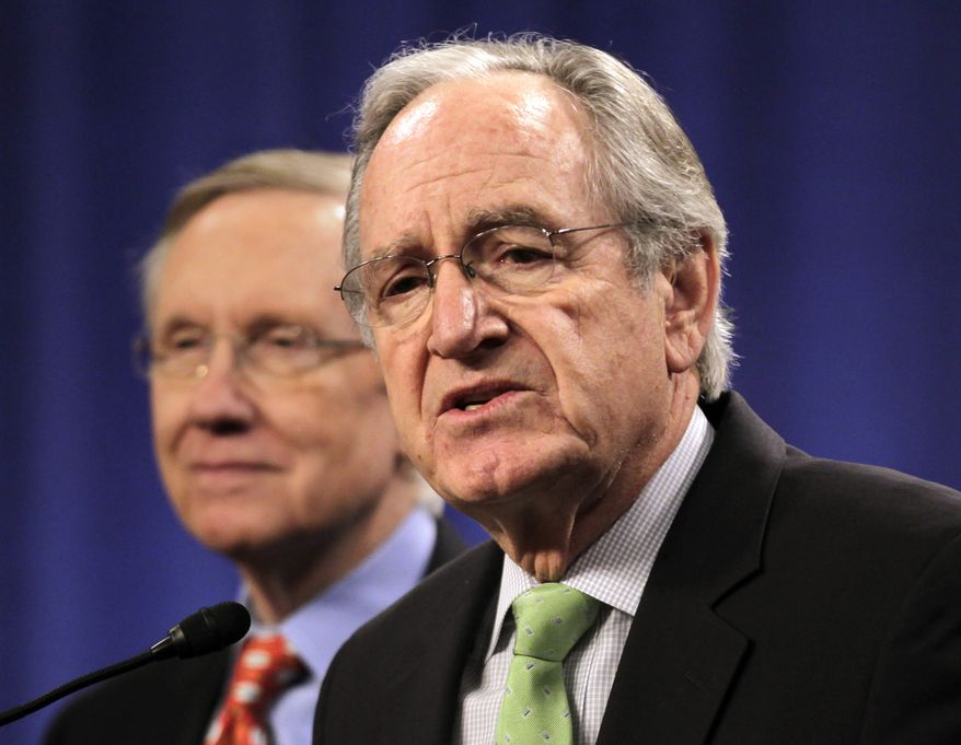 "**FILE** Sen. Tom Harkin (foreground), Iowa Democrat, joins Senate Majority Leader Harry Reid, Nevada Democrat, and other senators at a ""Back Off Social Security"" rally on Capitol Hill in Washington on March 28, 2011. (Associated Press)"
