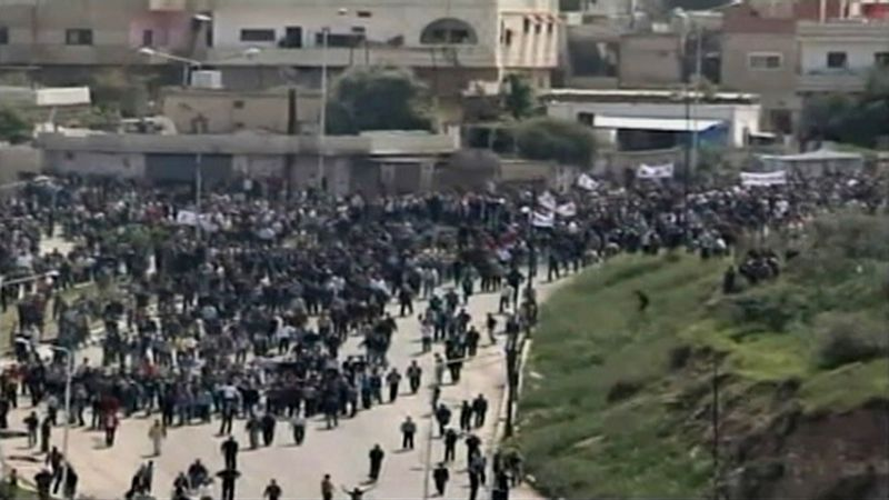 ** FILE ** In this image made from television, demonstrators march in Daraa, Syria, Friday, April 8, 2011. Thousands of protesters took to the streets of Daraa on Friday, a city in the south of Syria that has become a flashpoint for anti-government demonstrations. (AP Photo)