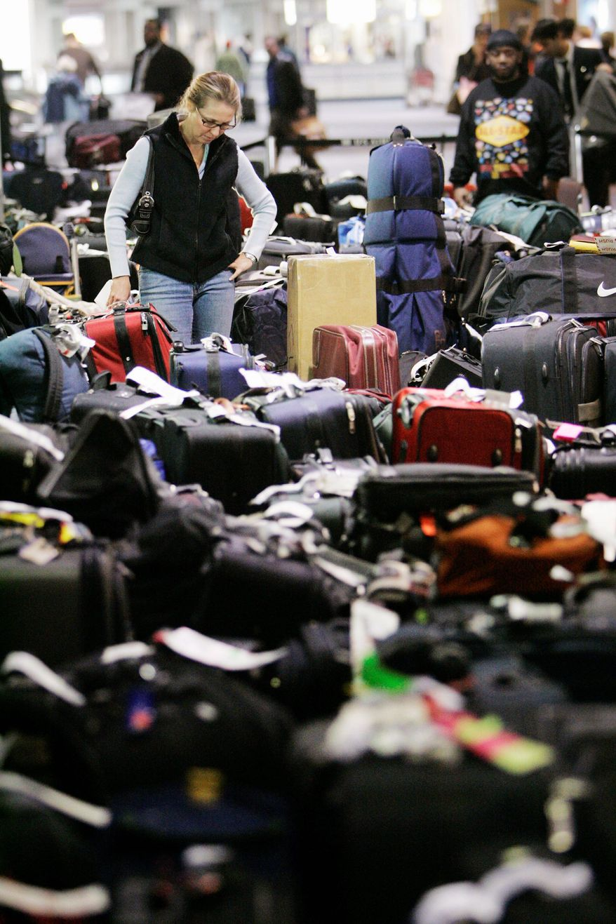 Carolann Manfredi, of Princeton, N.J., searches in 2007 for a bag she said had been missing for five days at the Philadelphia International Airport. The Department of Transportation is proposing a new rule this year requiring automatic refunds for delayed luggage. The major airlines, which charge checked-bag fees, are opposed. (Associated Press)