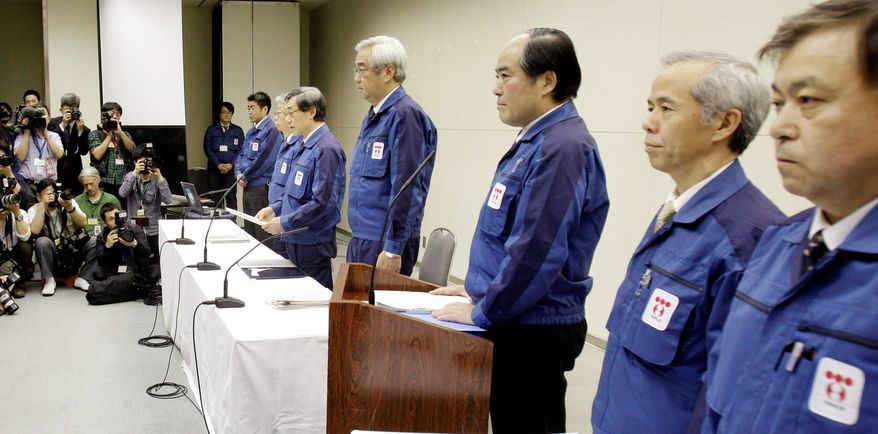 """""""I offer my apologies for having spread radiation. I apologize from the bottom of my heart,"""" said Tokyo Electric Power Co. President Masataka Shimizu (fifth from right) as he and other Tepco executives took questions for two hours Wednesday at Tepco headquarters in Tokyo. (Associated Press)"""