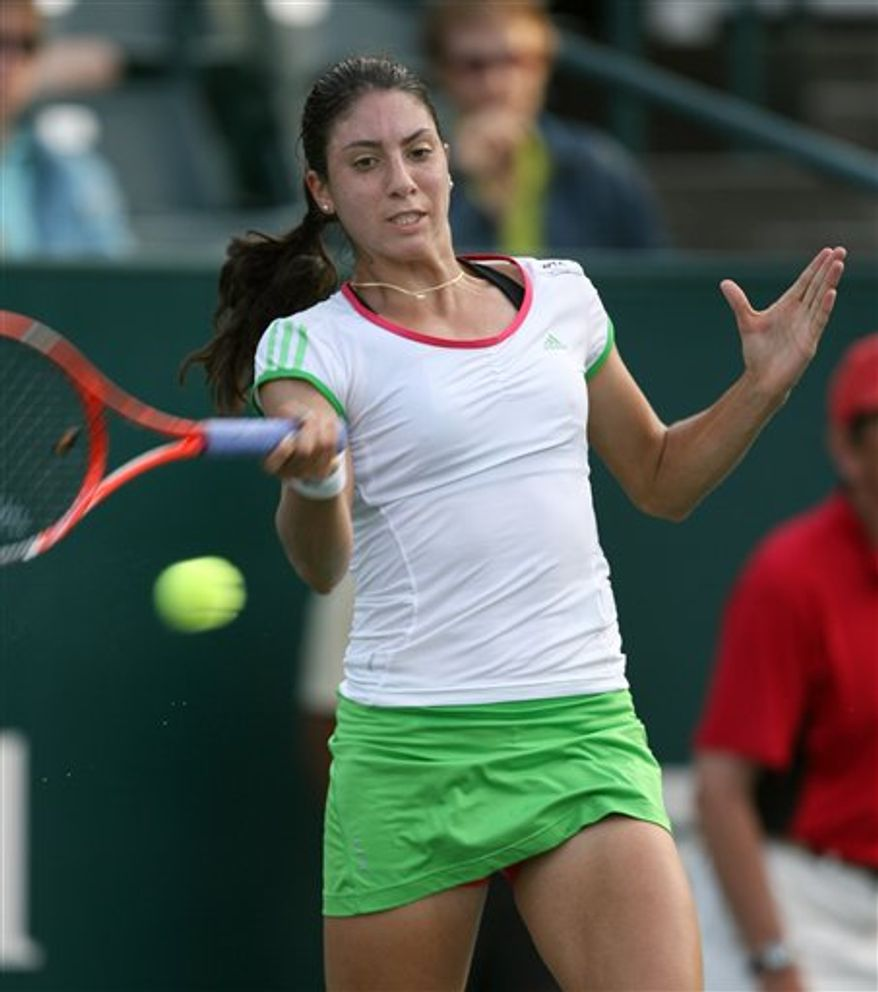 Christina McHale, of the United States, makes a return to Jelena Jankovic during the Family Circle Cup tennis tournament in Charleston, S.C., Friday April 8, 2011. Jankovic defeated McHale 6-2, 6-0.  (AP Photo/Mic Smith)