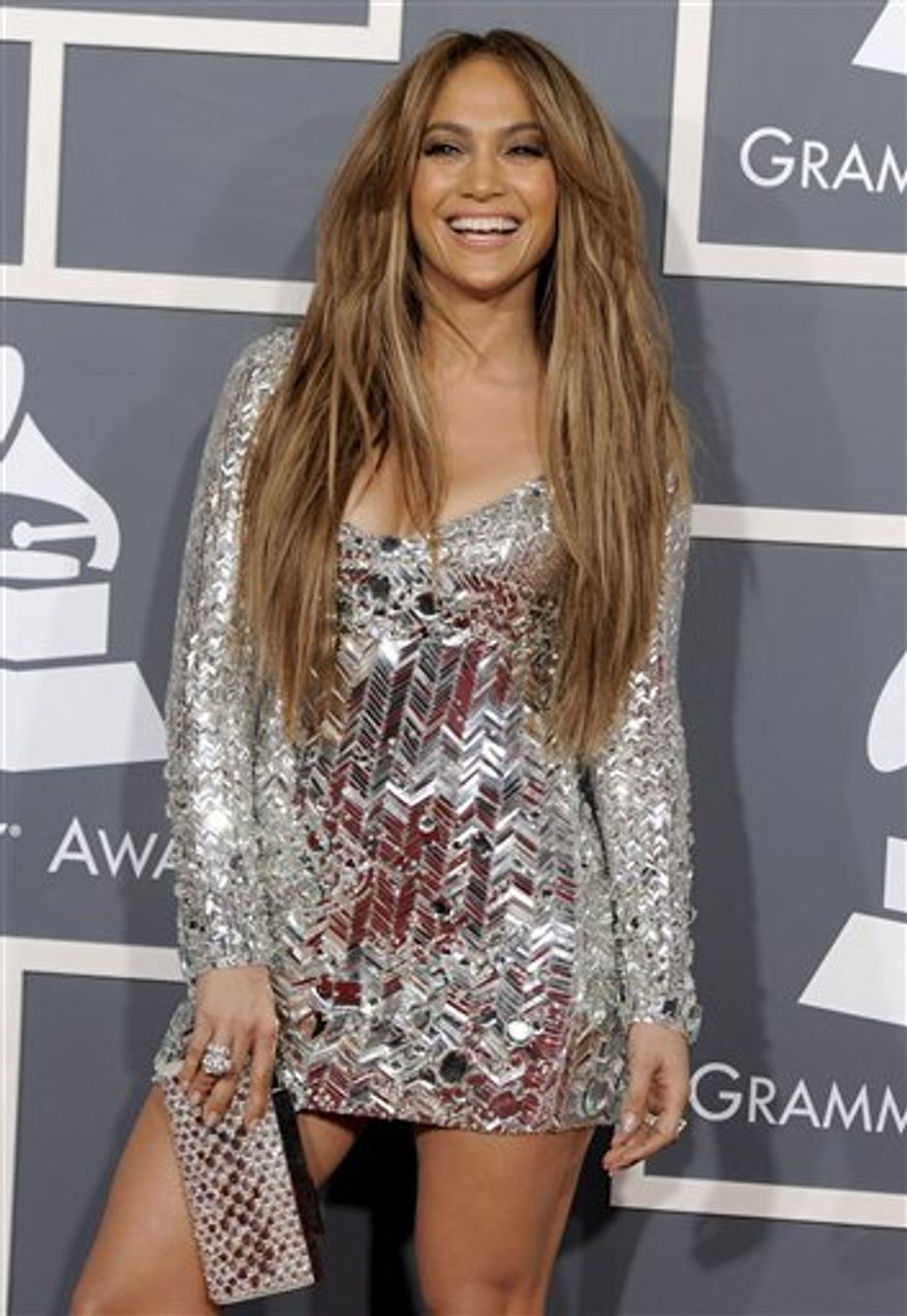 "FILE - In a Feb. 13, 2011 file photo, Jennifer Lopez arrives at the 53rd annual Grammy Awards, in Los Angeles. People magazine is naming Jennifer Lopez the World's Most Beautiful Woman. The singer, actress and ""American Idol"" judge tops the magazine's annual list of ""the World's Most Beautiful"" in a special double issue.  (AP Photo/Chris Pizzello, File)"