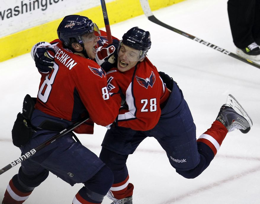 Washington Capitals' Alexander Semin (28) and Alex Ovechkin (8), both from Russia, celebrate Ovechkin's goal in the third period of Game 1 of a first-round NHL hockey playoff series with the New York Rangers, Wednesday, April 13, 2011, in Washington.(AP Photo/Alex Brandon)