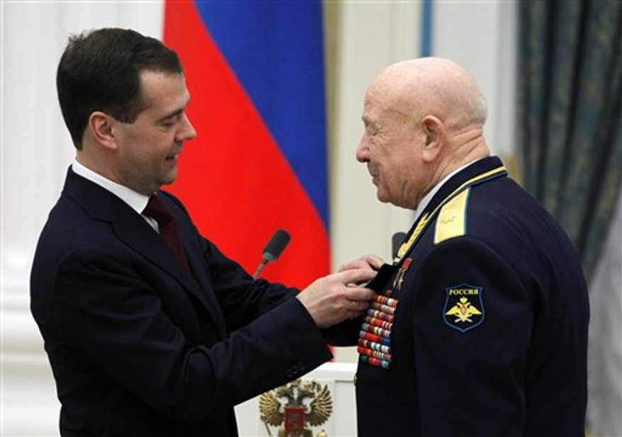 Russian President Dmitry Medvedev gestures while speaking at the award ceremony in the Kremlin in Moscow, Tuesday, April 12, 2011. The ceremony was held to mark the 50th anniversary of Yuri Gagarin's mission, the first human spaceflight. (AP photo/Alexander Natruskin, Pool)