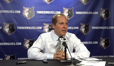 Minesota Timberwolves president David Kahn speaks at a news conference in Minneapolis, Wednesday April 13, 2011.  Kahn says owner Glen Taylor has assured him he will return next season. But Kahn declined to discuss the job status of coach Kurt Rambis on the day the Timberwolves wrapped up another disastrous season. Kahn spoke to the media hours before the Wolves were scheduled to host the Houston Rockets in the season finale. (AP Photo/The Star Tribune, Richard Sennott)
