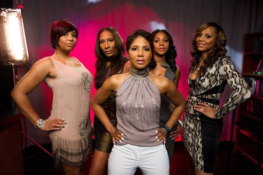 "In this April 4, 2011 photo, the Braxton sisters, Toni, center, and from left, Towanda, Traci, Trina and Tamar of the WeTV reality series, ""Braxton Family Values,"" pose for a portrait in New York. (AP Photo/Charles Sykes)"