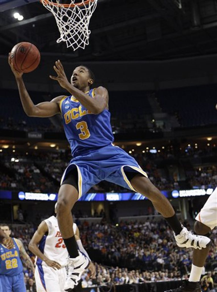 FILE - In this March 19, 2011, file photo, UCLA's Malcolm Lee (3) looks for a shot during a third-round Southeast regional NCAA tournament college basketball game against Florida in Tampa, Fla. Lee is leaving school to enter the NBA draft and he plans to hire an agent, ensuring he won't be eligible to return for his senior season. Lee said Tuesday , April 12, 2011, that he is immediately withdrawing from school. (AP Photo/Chris O'Meara, File)