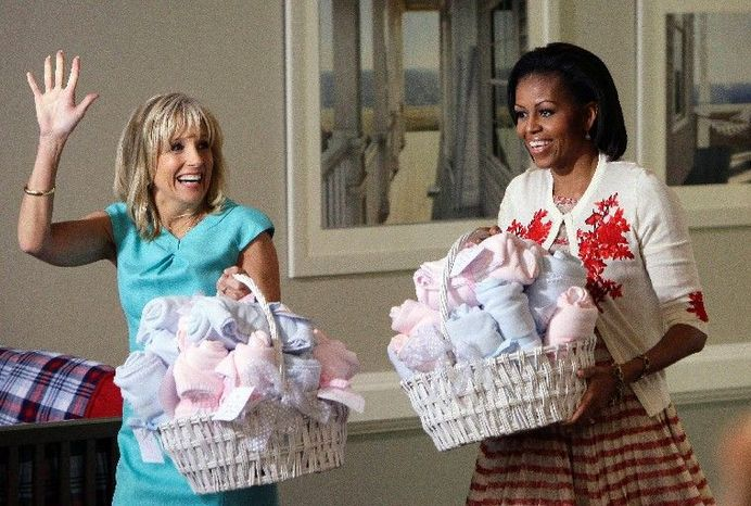"Jill Biden and first lady Michelle Obama bring gifts for expecting military wives at Camp Lejeune, N.C., on Wednesday. They will discuss their drive to support military families on ""The View"" Monday. (Associated Press)"
