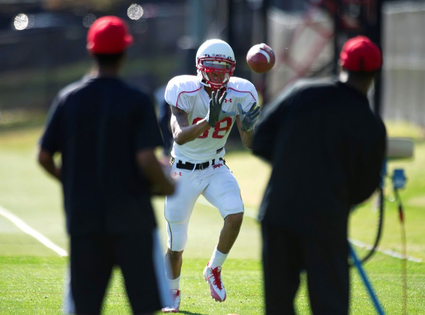 Cliff Tucker is a familiar face to Maryland baskeball fans, but with his eligibility in that sport done, he is trying to catch on with the Terps' football team as a wide receiver, a position he last played in high school. (Rod Lamkey/The Washington Times)
