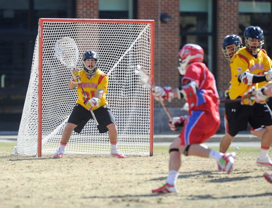 Niko Amato, shown in goal, measures his lacrosse career against that of Brian Dougherty, a two-time national goalie of the year with Maryland during the 1990s. (Maryland Athletics)