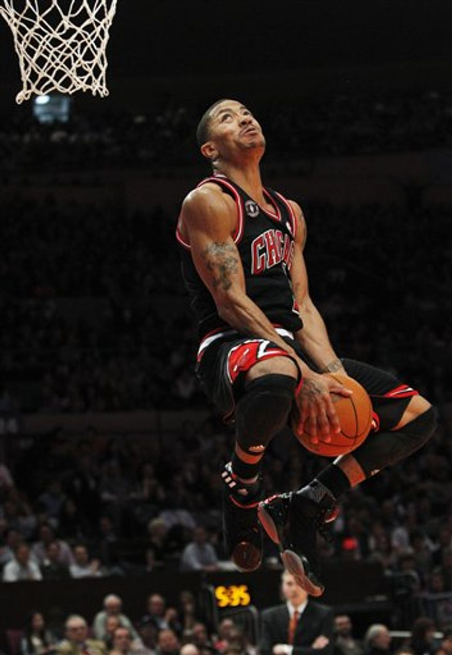 Chicago Bulls' Derrick Rose goes in for a dunk during the second half of the Bulls' NBA basketball game against the New York Knicks Tuesday, April 12, 2011, in New York. Rose scored 26 points as the Bulls won 103-90. (AP Photo/Frank Franklin II)