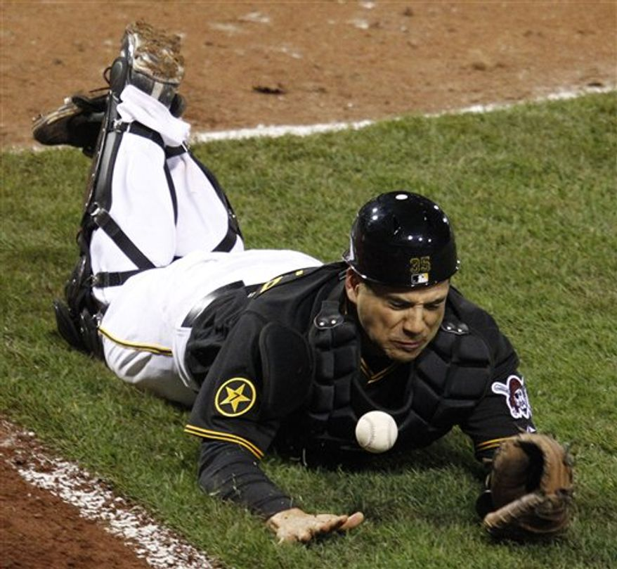 Pittsburgh Pirates catcher Jason Jaramillo dives but can't come up with a foul ball by Colorado Rockies' Jonathan Herrera in the 14th inning of a baseball game in Pittsburgh Friday, April 8, 2011. The Pirates won in the bottom of the 14th inning, 4-3. (AP Photo/Gene J. Puskar)