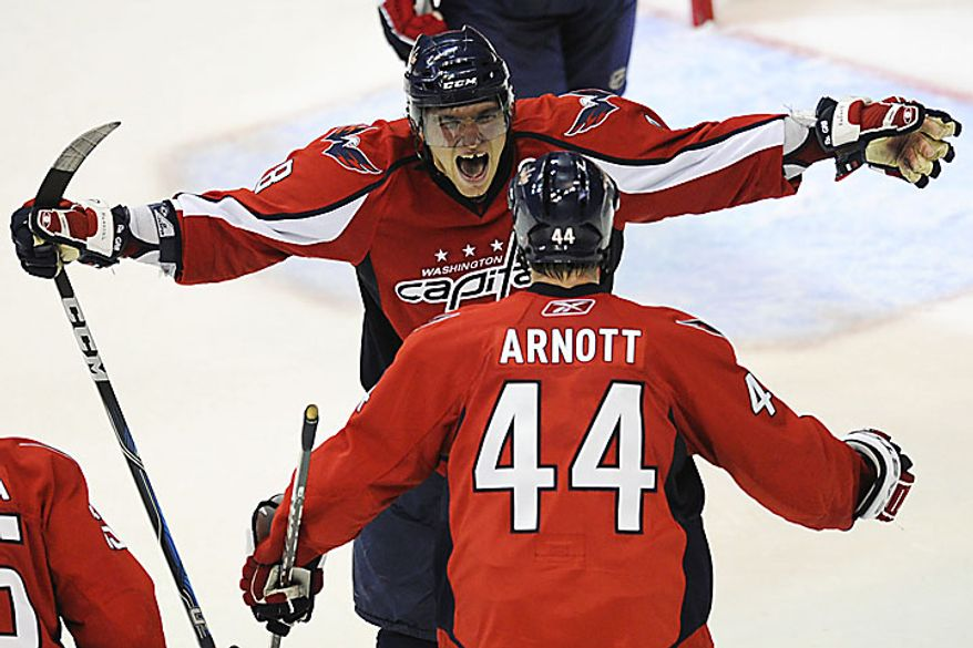 Capitals forward Alexander Ovechkin reaches out to Jason Arnott for a hug after Alexander Semin scored the winning goal in overtime to give the Capitals a 2-1 win over the Rangers in a playoff game at the Verizon Center in Washington on Wednesday, April 13, 2011. (Drew Angerer/The Washington Times)